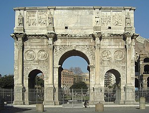 Arch of Constantine - South side, from Via triumphalis. Colosseum to right