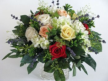 English: Bouquet of flowers made of silk flowe...