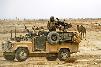"Air force infantry and special forces - Personnel of the Royal Air Force Regiment in a Land Rover with a Weapons Mount Installation Kit (""Wimik""), stopped on a road while conducting a combat mission near Kandahar Airfield, Afghanistan, in 2010."
