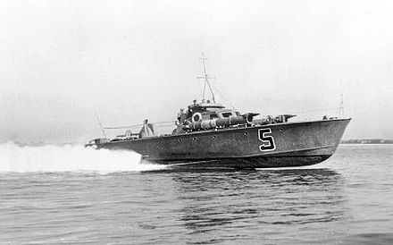 Royal Navy World War II MTB planing at speed on calm water showing its hard chine hull. Note how most of the bow of the boat is out of the water. Royal Navy MTB 5.jpg