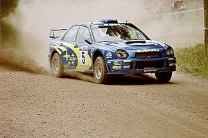 Richard Burns - Burns driving a Subaru Impreza WRC at the 2001 Rally Finland.