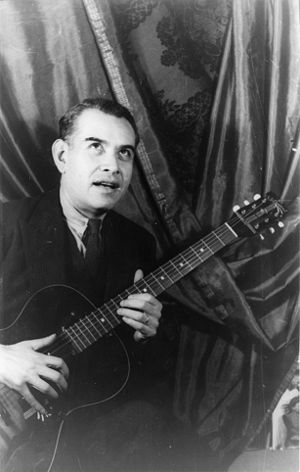 Rufino Tamayo - Rufino Tamayo holding a guitar 1945, Photo by: Carl Van Vechten