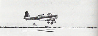 Marine Aviation Training Support Group 21 - Two SB2U-3s of VMSB-241, MAG-21, take off from Eastern Island shortly before the Battle of Midway