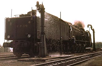 Tender (rail) - SNCF 241P Class with 34P bogie tender, being filled from a water crane (Nantes Blotterau, France, August 1969)