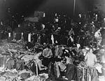 Sailors in hangar of USS San Jacinto (CVL-30) in April 1944.jpg