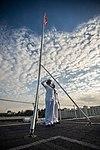 Sailors saluting First Navy Jack during morning colors aboard USS John C. Stennis (CVN-74) 160904-N-BR087-028.jpg