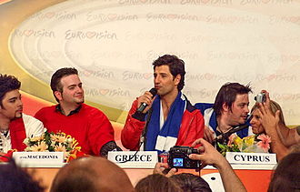 Greece in the Eurovision Song Contest 2004 - Rouvas speaking at a press conference after the Eurovision 2004 Semi-Final. Also featured are Macedonia's Toše Proeski and Cyprus' Lisa Andreas.