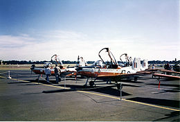 Single-engined military monoplanes with open canopies parked on an airfield