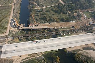 San Joaquin River - Crossings of California State Route 99 and the Union Pacific Railroad along the northern border of Fresno.  The early stages of construction of California High-Speed Rail's San Joaquin River Viaduct is also visible.