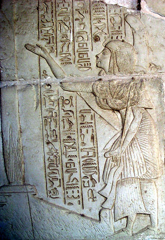 """Tomb of Horemheb - Horemheb, while still an official, receives the """"gold of the reward"""". The uraeus on his forehead was added later, after his coronation."""