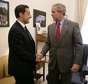 President George W. Bush drops by a meeting be...