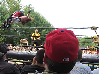 Moonsault - Scotty Vortekz performing a Spanish Fly on Dysfunction.