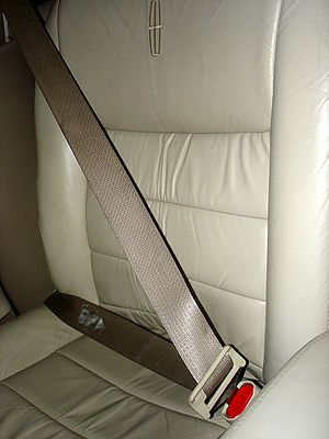 A three point seat belt in a Lincoln Town Car.