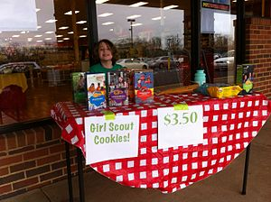 Girl Scout Cookies - A girl selling Girl Scout cookies