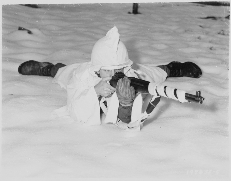 File:Sergeant. (or Tec 4) Marvin E. Eans, Jr., demonstrates the new snow cape being used by First U.S. Army Infantrymen in... - NARA - 531227.tif