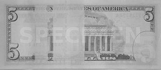 United States five-dollar bill - The reverse of the five-dollar bill has two rectangular strips that are blanked out when viewed in the infrared spectrum, as seen in this image taken by an infrared camera.