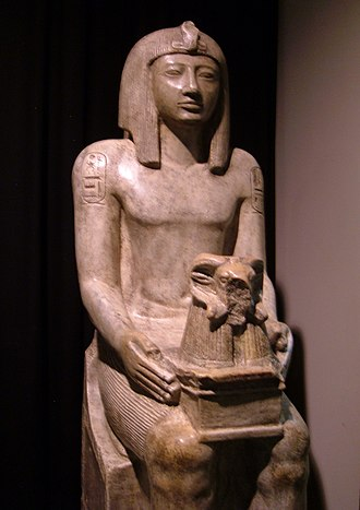 Seti II - A replica statue of Seti II holding a shrine to the god Amun on display at the Rosicrucian Egyptian Museum