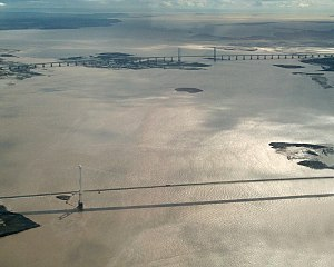 Severn crossing - Aerial view of both Severn bridges. The older Severn Bridge is in the foreground and the newer Second Severn Crossing in the background.