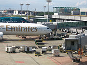 Ground handling of an Emirates Boeing 777-300 by CIAS in Terminal 1