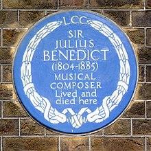 Plaque commemorating Benedict (Source: Wikimedia)