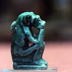 Sitted monkey eating-AF 6953