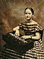 Sixth plate tintype of a young woman posed with a rocking melodeon (circa late-1850s), Found in New Hampshire (zoomed 400%, clipped).jpg