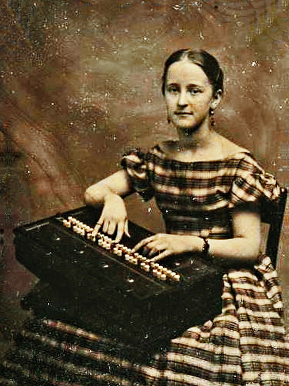 Sixth plate tintype of a young woman posed with a rocking melodeon (circa late-1850s), Found in New Hampshire (zoomed 400%25, clipped)