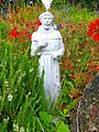Small statue of a Monk in the garden of Delgaty Castle - geograph.org.uk - 608069.jpg