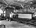 Snoqualmie Falls Lumber Co mill interior showing big log being cut be saw, Washington, 1919 (KINSEY 2745).jpeg