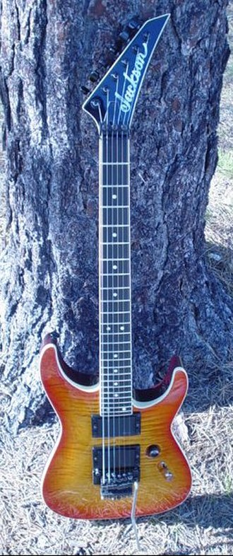 Jackson Soloist - This is a 1987 Soloist archtop. This was made with Brazilian rosewood fretboard, mahogany body and a flamed maple top. It was finished with nitrocellulose lacquer.