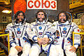 Soyuz TMA-05M crew in front of their spacecraft.jpg