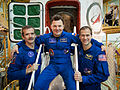Soyuz TMA-07M crew members in front of the spacecraft.jpg
