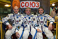 Soyuz TMA-13M crew in front of their spacecraft.jpg