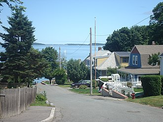 Squantum - Looking east over Quincy Bay down a neighborhood street in Squantum, Quincy, Massachusetts.