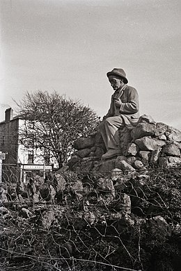 Statue of Pádraic Ó Conaire in Eyre Square Galway.jpg