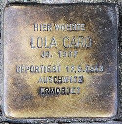 Photo of Lola Caro brass plaque