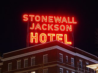 Stonewall Jackson Hotel - The Stonewall Jackson Hotel's red neon sign lit at night as seen from a nearby street