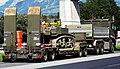 Swiss Army trailer with US Army tank.jpg