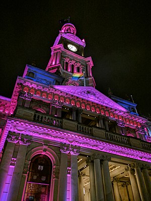 "Australian Marriage Law Postal Survey - Sydney Town Hall illuminated in pride colours and flying a rainbow flag in support of the ""Yes"" vote."