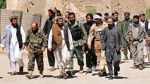 Taliban insurgents turn themselves in to Afghan National Security Forces at a forward operating base in Puza-i-Eshan -a