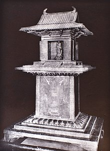 A black and white photograph of the Tamamushi Shrine