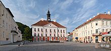 Tartu Town Hall and square, three story stone building with red hip roof
