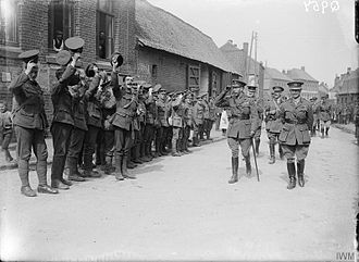 25th Infantry Brigade (United Kingdom) - King George V with Major-General Havelock Hudson (commanding 8th Division) walking through the streets of Fouquereuil, where the King was cheered by men of the 25th Brigade, 11 August 1916.