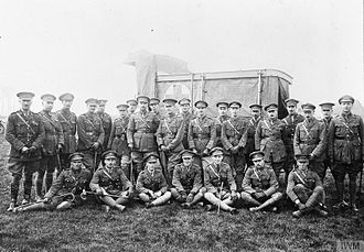 Middlesex Regiment - Lieutenant-Colonel John Hamilton Hall (standing directly in front of the Red Cross on the ambulance), the CO of the 1st Battalion, Middlesex Regiment (98th Brigade, 33rd Division), with his officers. Photograph taken during the battalion's rest near Cassel, 25 April 1918.