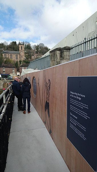 While the bridge was being restored in 2018, English Heritage installed interpretation panels along the walkway. The Iron Bridge during restoration in 2018.jpg