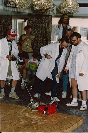 "Robot combat - Critter Crunch in 1991, at the moment when ""Agent Orange"" beat Bill Lewellyn's critter to win the event."