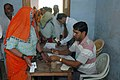 The Polling officer administering indelible ink at the finger of a female voter at a polling booth of Jalgaon, in Alwar Rajasthan, during the 4th Phase of General Election-2009 on May 07, 2009.jpg