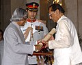 The President, Dr. A.P.J. Abdul Kalam presenting Padma Bhushan to a veteran freedom fighter, Shri Shashi Bhushan, at investiture ceremony in New Delhi on March 29, 2006.jpg