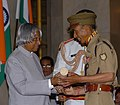The President, Dr. A.P.J. Abdul Kalam presenting Padma Shri to a great mountaineer of international repute, Shri Mohan Singh Gunjyal at investiture ceremony in New Delhi on March 29, 2006.jpg