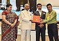 The President, Shri Ram Nath Kovind presenting the Swarna Kamal Award to Bobby Washengbam (Best Book on Cinema), at the 65th National Film Awards Function, in New Delhi.JPG